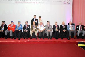 Dr. Tae Yun Kim and the SF Consul General with the Veterans Image